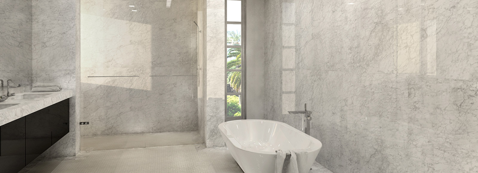 A wide image of a bathroom with marbled walls, a tall shower and a white, free-standing bathtub with a steel faucet.